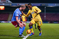 AFC Wimbledon forward Dominic Poleon (10) takes on Scunthorpe United defender David Mirfin (6)  during the EFL Sky Bet League 1 match between Scunthorpe United and AFC Wimbledon at Glanford Park, Scunthorpe, England on 28 February 2017. Photo by Simon Davies.