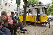 Old people await for tram 28 to leave Graça district, on the top of one of Lisbon's seven hills