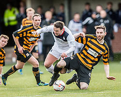 Falkirk's Mark Millar tackled by Alloa Athletic's Ben Gordon.<br /> Alloa Athletic 3 v 0 Falkirk, Scottish Championship game played today at Alloa Athletic's home ground, Recreation Park.<br /> © Michael Schofield.