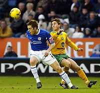 Photo: Chris Ratcliffe.<br />Leicester City v Norwich City. Coca Cola Championship. 31/12/2005.<br />Paul McVeigh (R) of Norwich tussles with Alan Maybury of Leicester.
