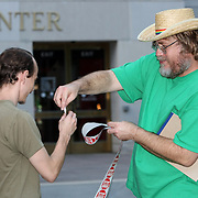 A supporter hands out Greed stickers during an Occupy Orlando public demonstration in support of Occupy Wall Street gatherings across the country, at the Orange County History Center on Wednesday, October 5, 2011 in Orlando, Florida. (AP Photo/Alex Menendez)