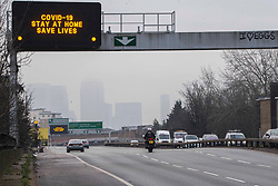 © Licensed to London News Pictures.15/01/2021, London, UK. A number of cars drive past a Covid-19 information display on the A12 in Hackney, east London as the Coronavirus death toll in the UK rose by 1,248 yesterday, the third highest daily increase during the pandemic. Photo credit: Marcin Nowak/LNP