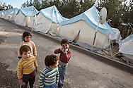 Brahim, right, plays with a toy gun in Yayladagi refugee camp for Syrians in southern Turkey. 12/21/2012 Bradley Secker for the Washington Post