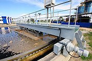 Sewerage treatment facility. The treated water is then used for irrigation and agricultural use. Photographed near Hadera, Israel <br /> Secondary sedimentation pools the sludge is removed to the sludge treatment
