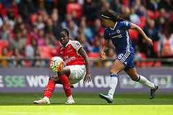 Asisat Oshoala of Arsenal Ladies crosses under pressure from Ana Marques Borges of Chelsea Ladies - Mandatory byline: Jason Brown/JMP - 14/05/2016 - FOOTBALL - Wembley Stadium - London, England - Arsenal Ladies v Chelsea Ladies - SSE Women's FA Cup