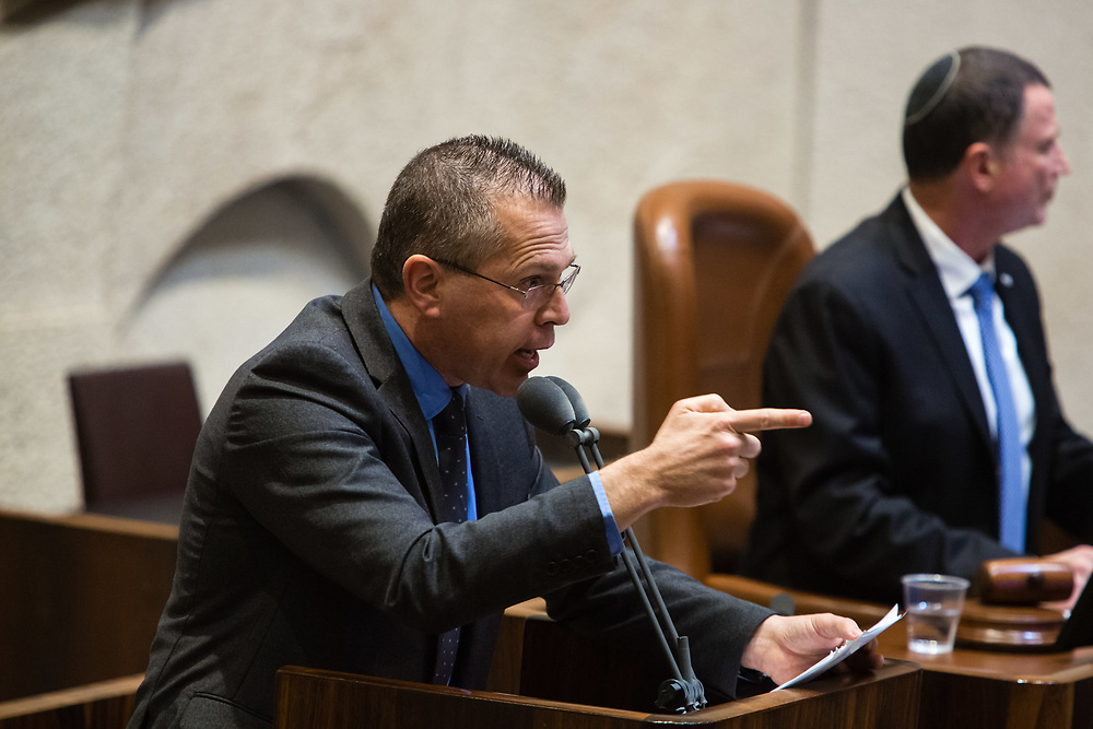 Israeli Public Security Minister, Gilad Erdan gestures as he speaks at the Knesset, Israel's parliament in Jerusalem, on January 25, 2017.