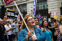 London, July 1st 2017. Anti-Tory protesters march from the BBC's headquarters through the streets of London to Parliament in London following the Conservative Party's £1.5 billion deal with the DUP to enable a slim majority in the House of Commons.