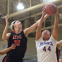 Miyamura Patriot Alaiah Nelson (44) attempts to grab a rebounded ball before Aztec Tigers Reigan Weaver (32) during the game at Miyamura Saturday.