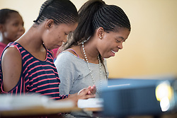 2 March 2017, Ma Mafefooane Valley, Lesotho: Rosaleah Lobako (left) and Diny Makanyane (right) are first-year students in the general nursing programme. Here, during anatomy class, as part of a course in Anatomy and physiology for first-year students. This lesson is on the neural system. The class consists of 31 students, both men and women, and is in its second semester. The Roma College of Nursing is a Roman Catholic non-profic institution under the Christian Health Association of Lesotho. The college educates nurses and midwives, and is situated adjacent to Saint Joseph's Hospital in the Ha Mafefooane Valley, some 35 kilometers from Lesotho's capital, Maseru. The school forms an integral part of Saint Joseph's Hospital, where the students acquire essential parts of their hands-on training. The school was founded in 1972, and is open to candidates of any gender and various religious backgrounds. Applications are also open to students from other countries. Most students begin their studies at the age of 19-20. Most are from Lesotho, but some are international. The college hosts a total of some 120 students. Four out of five are women. Through sponsorship from ICAP and the Nursing Education Partnership Initiative (NEPI), which draws funds from PEPFAR, the school maintains a library and a skills laboratory specifically designed to improve nursing education in Lesotho. There are six nursing training institutions in Lesotho in total, of which four are denominational as part of the Christian Health Association of Lesotho, and thus owned by the churches. Two institutions are public, run by the government.