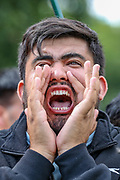 """A passionate protestor shouts """"Sanction Pakistan"""" during a protest organised by the Afghan women along with their family members outside the Houses of Parliament in central London on Wednesday, Aug 18, 2021. VX Photo/ Vudi Xhymshiti)"""