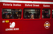 1990s commuters stare out the window of their red London Routemaster bus, operated by Leaside Buses, on 19th June 1994.  The bus is a traditional design called a Routemaster which has been in service on the capital's roads since 1954 and is nowadays only seen on heritage routes. From any angle, the bus is easily recognisable as that classic British transport icon.