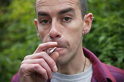 Portrait of a man smoking,