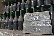 Bottles aging in the cellar. Marc de Bourgogne. Domaine Bertagna, Vougeot, Cote de Nuits, d'Or, Burgundy, France