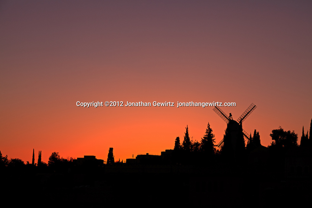 The Moses Montefiore windmill at Yemin Moshe at sunset. WATERMARKS WILL NOT APPEAR ON PRINTS OR LICENSED IMAGES.