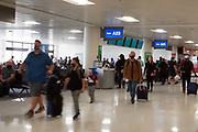 People walk through Terminal 4 of the Sky Harbor International Airport, Thursday, April 1, 2021, in Phoenix.