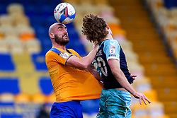 Farrend Rawson of Mansfield Town gets a head to the ball - Mandatory by-line: Ryan Crockett/JMP - 20/02/2021 - FOOTBALL - One Call Stadium - Mansfield, England - Mansfield Town v Cambridge United - Sky Bet League Two