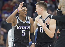 March 1, 2018 - Sacramento, CA, USA - The Sacramento Kings' De'Aaron Fox (5) celebrates a basket with teammate Bogdan Bogdanovic (8) against the Brooklyn Nets at the Golden 1 Center in Sacramento, Calif., on Thursday, March 1, 2018. (Credit Image: © Hector Amezcua/TNS via ZUMA Wire)