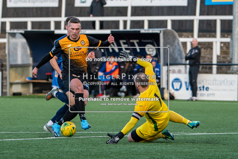 BROMLEY, UK - JANUARY 04: Joseph Taylor, of Cray Wanderers FC, takes the ball around Shane Gore, of Wingate & Finchley,  during the BetVictor Isthmian Premier League match between Cray Wanderers and Wingate & Finchley at Hayes Lane on January 4, 2020 in Bromley, UK. <br /> (Photo: Jon Hilliger)