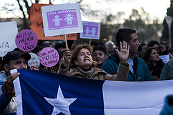 July 20, 2017 - Osorno, Los Lagos, Chile - Osorno, Chile. 20 July 2017. Demonstrators in favor of the ''Bus de la Familia'' carry posters with phrases against gender ideology..In the afternoon of today, the so-called ''Bus de la Familia'' arrived in Osorno, an initiative of the Coordinator of Pastoral Units of Chile, which toured the cities of Concepción, Temuco, Puerto Montt, Purranque and Osorno. The tour of this bus is part of a campaign of the evangelical world, which aims to convey the same message as the previous one: to make known its position of rejection before the ideology of gender and the new concepts of family and homosexuality in Osorno, Chile. (Credit Image: © Fernando Lavoz/NurPhoto via ZUMA Press)