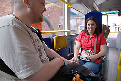 Young woman with Cerebral Palsy in a wheelchair with her boyfriend on a bus,
