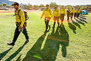 26 JUNE 2005 - CAVE CREEK, AZ:   Members of the Navajo Scouts firefighting team from Ft. Defiance march out of camp to their vehicles before being dispatched to the Cave Creek Complex fire line Sunday morning. The Cave Creek Complex fire was the third largest wildfire in the state of Arizona to date, after the Rodeo-Chediski fire and Wallow Fire. The fire started on June 21, 2005 by a lightning strike during a monsoon storm and burned 243,950 acres (987.2 km2).   PHOTO BY JACK KURTZ