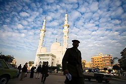 Egyptians walk outside the main mosque in Mansoura, Egypt, Dec. 27, 2005. Amr Khaled, an Islamic televangelist says, Mansoura is one of Life Makers most powerful chapters. Khaled, had previously been asked to leave Egypt as his revival gained strength. As a result he started preaching on several television shows, turning him into an international celebrity. Some religious scholars complain that Khaled has not been properly trained in Islam to command such a following.