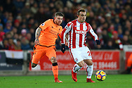 Xherdan Shaqiri of Stoke City looks to get away from Alberto Moreno of Liverpool. Premier league match, Stoke City v Liverpool at the Bet365 Stadium in Stoke on Trent, Staffs on Wednesday 29th November 2017.<br /> pic by Chris Stading, Andrew Orchard sports photography.