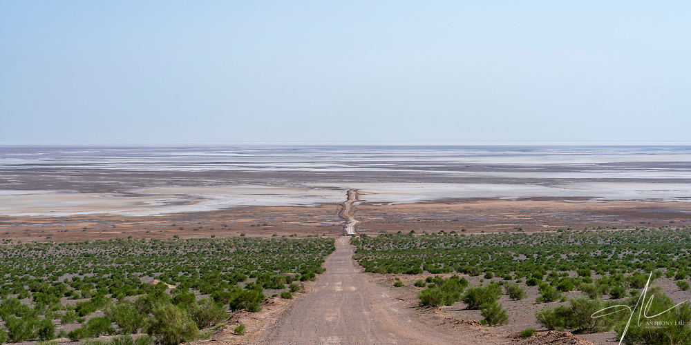 The road leading into a salt lake located in between Tehran and Kashan.