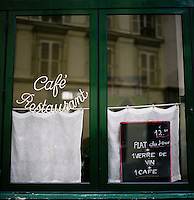 A menu sits in the window of a cafe/restaurant in the Latin Quarter section of Paris.<br /> <br /> NOTE: Larger resolution versions of these images are available on request.