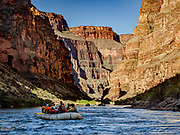 Canyon walls tower over our boats on Day 13 of 16 days rafting 226 miles down the Colorado River in Grand Canyon National Park, Arizona, USA.