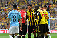 Etienne Capoue (29) of Watford and Abdoulaye Doucoure (16) of Watford argue with referee Kevin Friend during the The FA Cup Final match between Manchester City and Watford at Wembley Stadium, London, England on 18 May 2019.