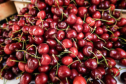 Heap of cherries for sale at market, Puglia, Italy