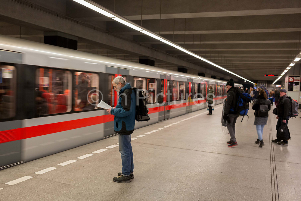 Commuters wait to board an arriving Metro train at Pragues Hlavni Nadrazi Metro Station, on 18th March, 2018, in Prague, the Czech Republic.