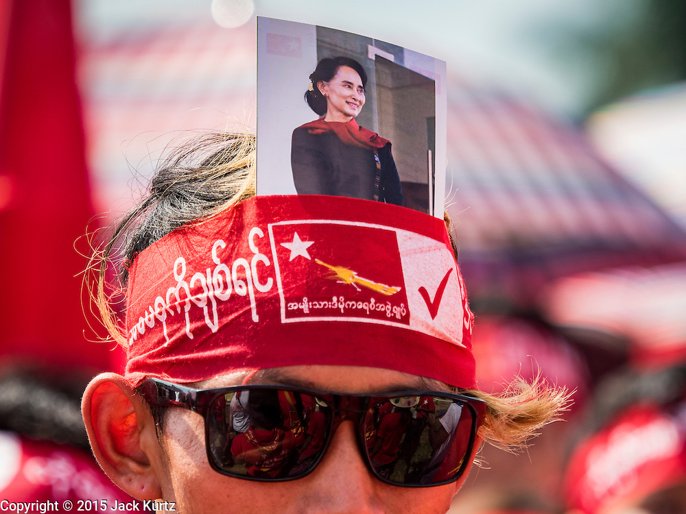 01 NOVEMBER 2015 - YANGON, MYANMAR: A man with a photo of Aung San Suu Kyi, leader of the oppositon NLD, tucked into his bandana at a NLD rally near Yangon Sunday. Political parties are wrapping up their campaigns in Myanmar (Burma). National elections are scheduled for Sunday Nov. 8. The two principal parties are the National League for Democracy (NLD), the party of democracy icon and Nobel Peace Prize winner Aung San Suu Kyi, and the ruling Union Solidarity and Development Party (USDP), led by incumbent President Thein Sein. There are more than 30 parties campaigning for national and local offices.    PHOTO BY JACK KURTZ
