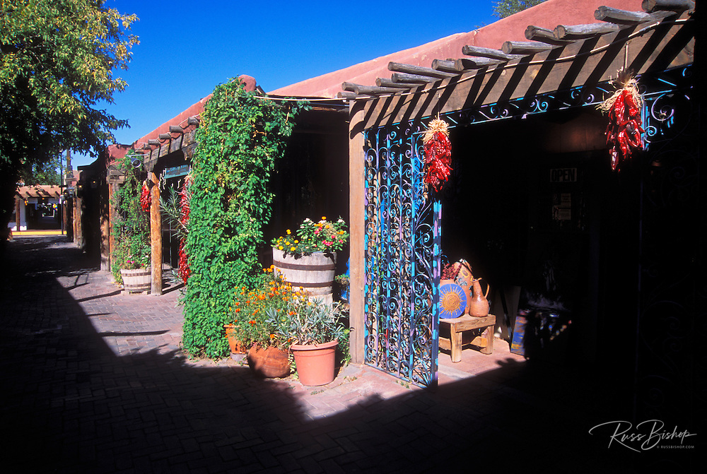 Chili ristras and potted flowers adorn alley shops in Old Town, Albuquerque, New Mexico