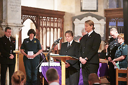 © Licensed to London News Pictures.  17/11/2013. THAME, UK. Names of those that died are read out during the annual Road Deaths Memorial Service held in St Marys Church, Thame. 78 people were killed in traffic accidents in the Thames Valley Police area last year.   Photo credit: Cliff Hide/LNP