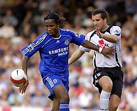 Photo: Daniel Hambury.<br />Fulham v Chelsea. The Barclays Premiership. 23/09/2006.<br />Fulham's Ian Pearce battles with Chelsea's Didier Drogba.