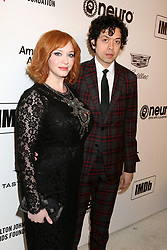 February 24, 2019 - West Hollywood, CA, USA - LOS ANGELES - FEB 24:  Christina Hendricks, Geoffrey Arend at the Elton John Oscar Viewing Party on the West Hollywood Park on February 24, 2019 in West Hollywood, CA (Credit Image: © Kay Blake/ZUMA Wire)