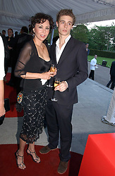 Model MARIE HELVIN and MAX IRONS son of Jeremy Irons at a party to celebrate the opening of Roger Vivier in London held at The Orangery, Kensington Palace, London on 10th May 2006.<br /><br />NON EXCLUSIVE - WORLD RIGHTS