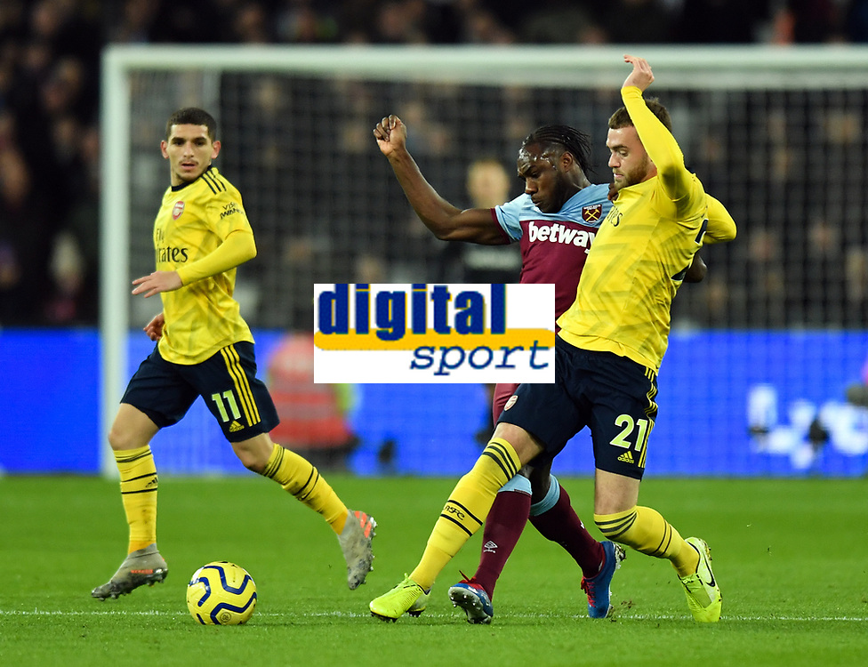 Football - 2019 / 2020 Premier League - West Ham United vs. Arsenal<br /> <br /> West Ham United's Michail Antonio battles for possession with Arsenal's Calum Chambers, at The London Stadium.<br /> <br /> COLORSPORT/ASHLEY WESTERN