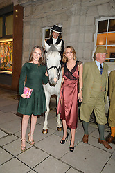 Left to right, LADY ELIZA MANNERS, the DUCHESS OF RUTLAND and LADY ALICE MANNERS at a party to celebrate the publication of Capability Brown & Belvoir - Discovering a lost Landscape by The Duchess of Rutland, held at Christie's, 8 King Street, St.James, London on 7th October 2015.