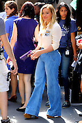 August 17, 2016 - New York, New York, United States -<br /> <br />  Actress Hilary Duff carries a copy of 'Harry Potter and the Sorcerer's Stone' on the set of the TV show 'Younger' <br /> ©Exclusivepix Media