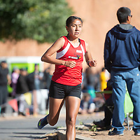 Ali Upshaw of St. Michaels Indian School finishes first with a time of 19:17.11 in the 5,000 meters girls varsity race Saturday, Oct. 5 at the Curtis Williams Invitational at Red Rock Park in Gallup.