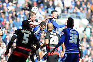 Cardiff City's Sean Morrison (centre right) is challenged by QPR's Clint Hill (centre left). Skybet football league championship match, Cardiff city v Queens Park Rangers at the Cardiff city stadium in Cardiff, South Wales on Saturday 16th April 2016.<br /> pic by Carl Robertson, Andrew Orchard sports photography.
