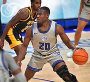 St Louis Billikens guard Fred Thatch Jr. (20) looks for an open teammate. St. Louis University hosted the University of Arkansas - Pine Bluff in a mens basketball game on December 5, 2020 at Chaifetz Arena on the SLU campus in St. Louis, MO.<br /> Photo by Tim Vizer