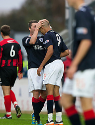 Falkirk's Tam Scobie with Farid El Alagui after he was brought down for a penalty..Falkirk 1 v 0 Queen of the South, 15/10/2011..Pic © Michael Schofield.