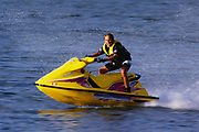 Teenage boy riding his jetski.