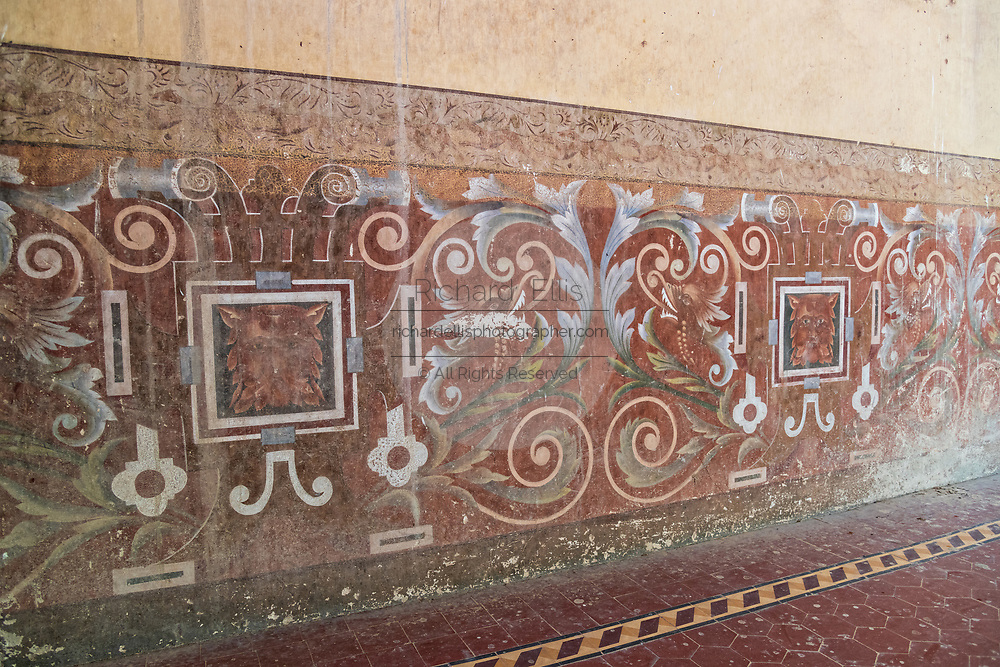 View of hand painted wallpaper in the derelict and fading Hacienda de Jaral de Berrio in Jaral de Berrios, Guanajuato, Mexico. The abandoned Jaral de Berrio hacienda was once the largest in Mexico and housed over 6,000 people on the property and is credited with creating Mescal.