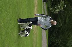 Eddie Sander with his Dogs Jackson and Inka<br /><br />18 June 2004<br /><br />Copyright Paul David Drabble<br /> [#Beginning of Shooting Data Section]<br />Nikon D1 <br /> Focal Length: 80mm<br /> Optimize Image: <br /> Color Mode: <br /> Noise Reduction: <br /> 2004/06/18 09:40:08.1<br /> Exposure Mode: Manual<br /> White Balance: Auto<br /> Tone Comp: Normal<br /> JPEG (8-bit) Fine<br /> Metering Mode: Center-Weighted<br /> AF Mode: AF-S<br /> Hue Adjustment: <br /> Image Size:  2000 x 1312<br /> 1/200 sec - F/7.1<br /> Flash Sync Mode: Not Attached<br /> Saturation: <br /> Color<br /> Exposure Comp.: 0 EV<br /> Sharpening: Normal<br /> Lens: 80-200mm F/2.8<br /> Sensitivity: ISO 200<br /> Image Comment: <br /> [#End of Shooting Data Section]