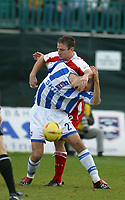 Photo: Jo Caird<br /> Nationwide Football League Div 2<br /> Brighton & Albion v Bristol City<br /> 15/11/03<br /> <br /> Chris McPhee is smothered by Louis Carey